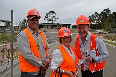 Hard hats, safety jackets and happy smiles all round
