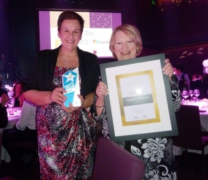 Karen and Suzanne holding the award and certificate